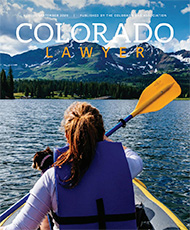 Colorado Lawyer Cover with woman on boat